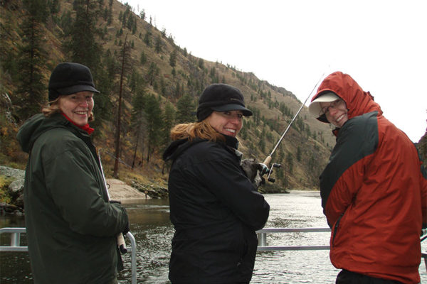 Owner Madeleine Turnbull with her mom and mother-in-law staying warm and enjoying a day of fishing on the Salmon River.