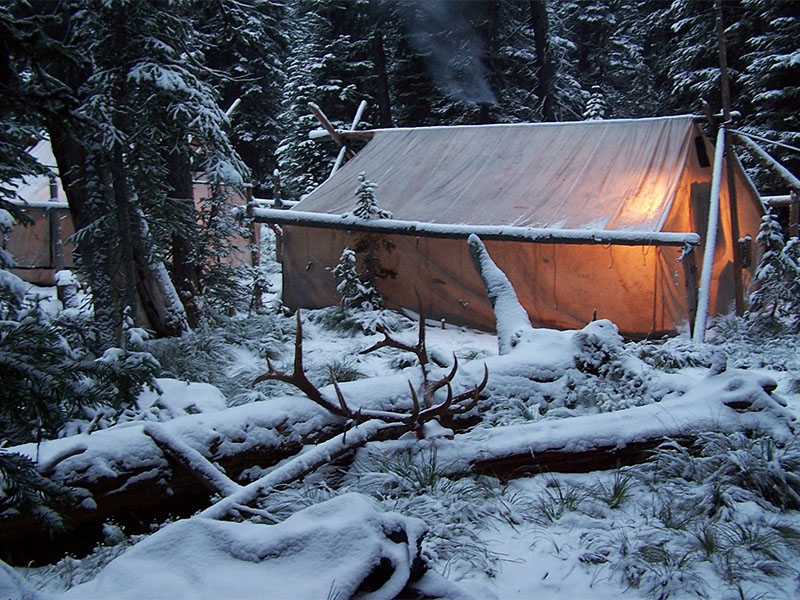 Hunting camp in the snow.