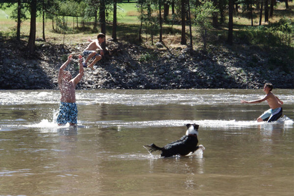 Playing in the river is a family favorite during the warm summer days at Shepp Ranch.