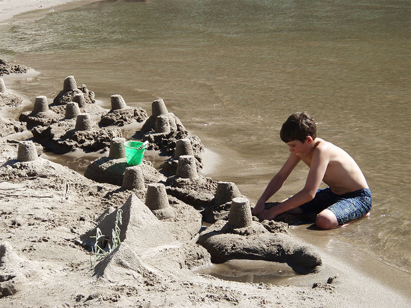 The beach of the Salmon River makes an excellent playground in the summer.